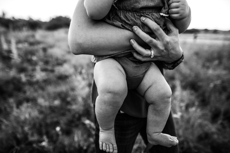 Salt Lake City Birth and Family Photography, close up black and white of baby's legs while being held by mother