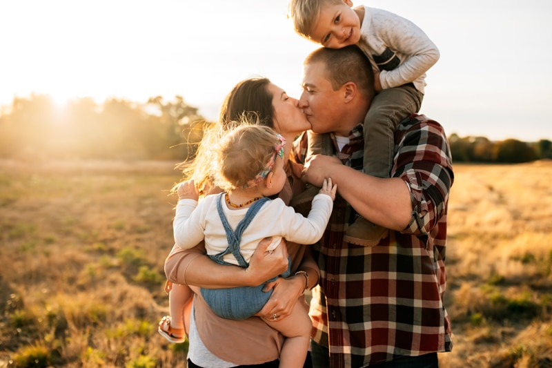 Salt Lake City Birth and Family Photography, family of four with couple kissing