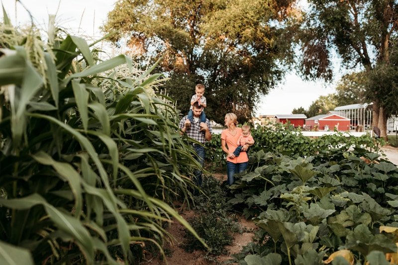 Salt Lake City Birth and Family Photography, family of 4 walking in a farm field