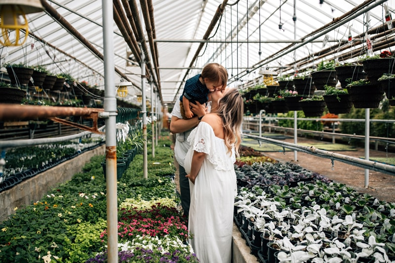 Salt Lake City Birth and Family Photography, couple playing with toddler in a flower center