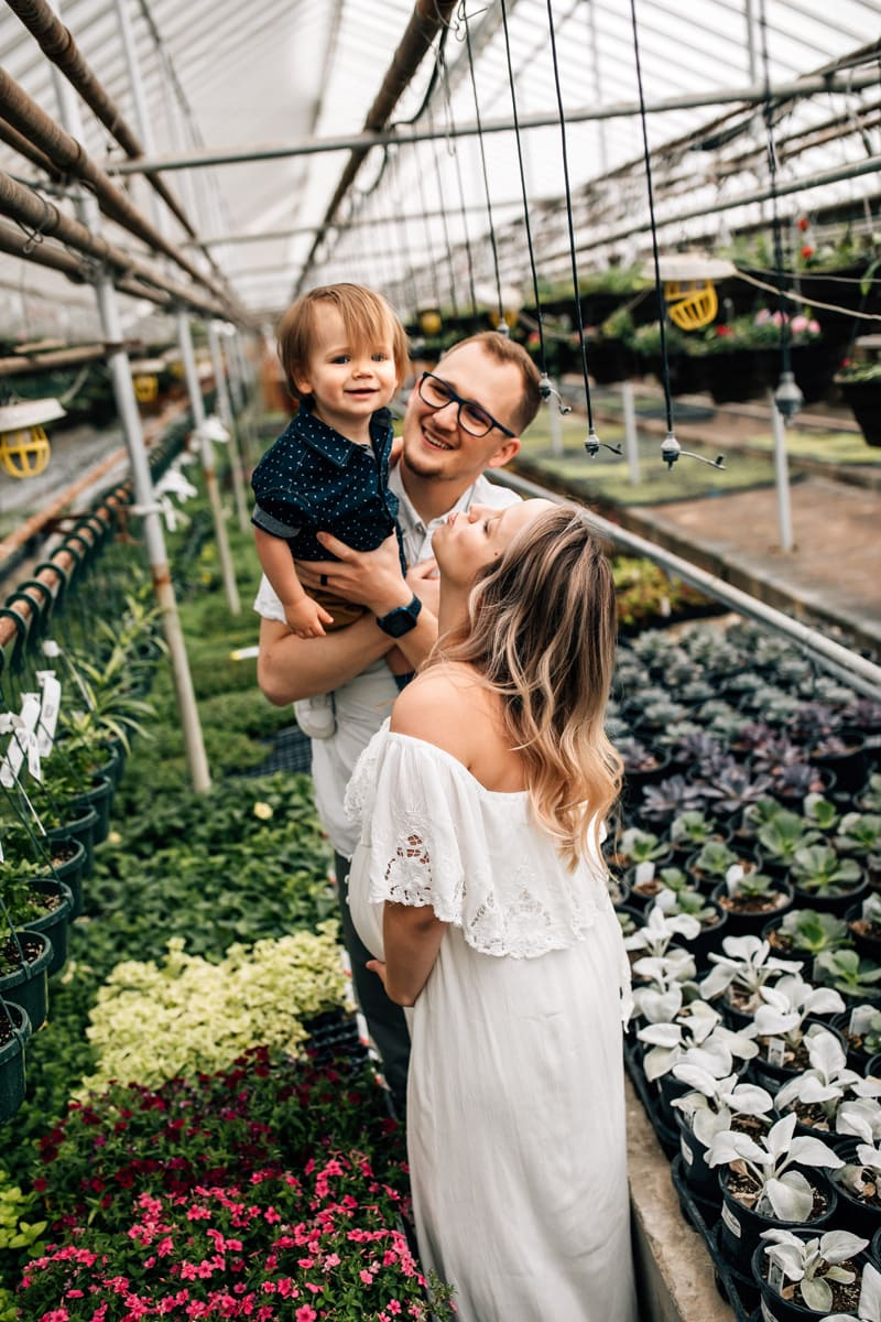 Salt Lake City Birth and Family Photography, couple playing with toddler boy in a garden center