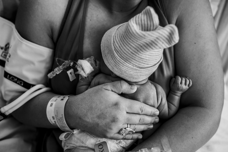 Salt Lake City Birth and Family Photography, black and white of new baby resting on mother's chest