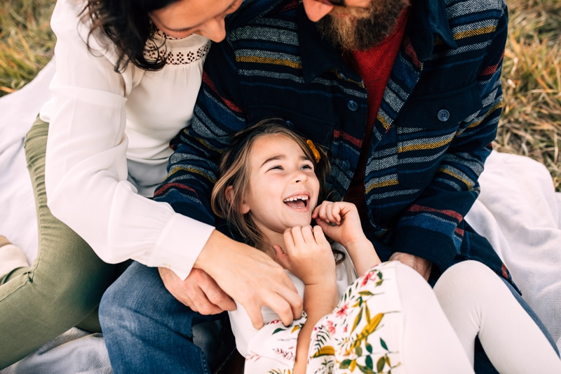 Salt Lake City Birth and Family Photography, family of three tickling daughter