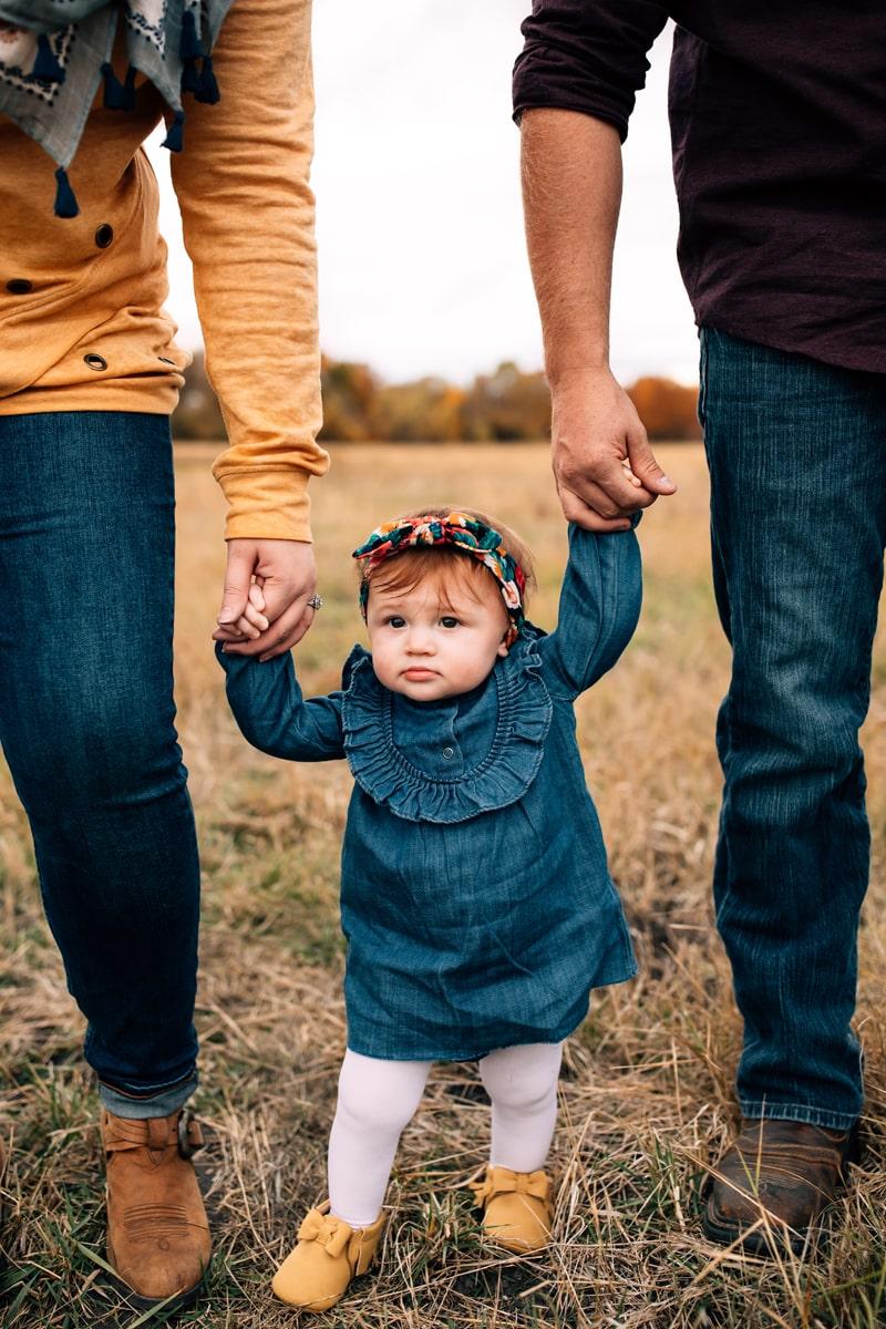 Salt Lake City Birth and Family Photography, couple standing with little girl holding hands between them