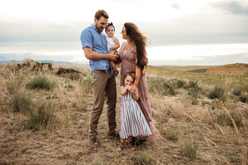 Salt Lake City Birth and Family Photography, family of 4 in a grassy field