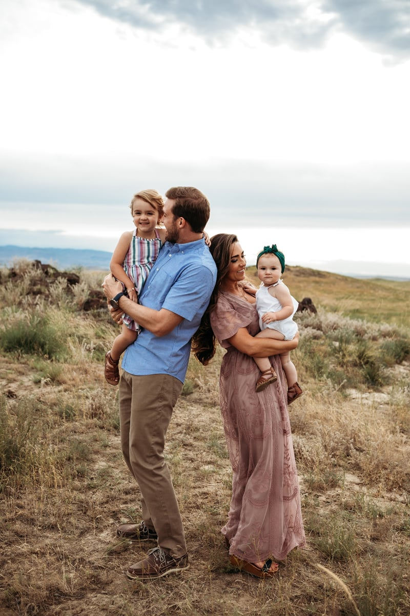 Salt Lake City Birth and Family Photography, family of four standing together in a field