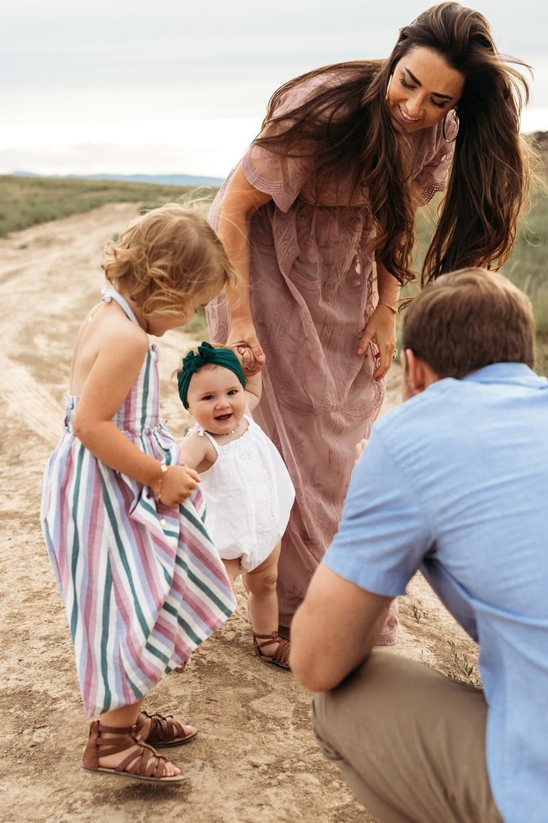 Salt Lake City Birth and Family Photography, family of 4 walking little baby girl next to them