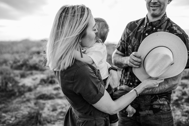 Salt Lake City Birth and Family Photography, black and white of family of three cuddling in a field