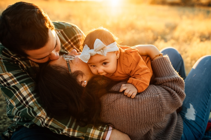 Salt Lake City Birth and Family Photography, couple playing with little baby in a field