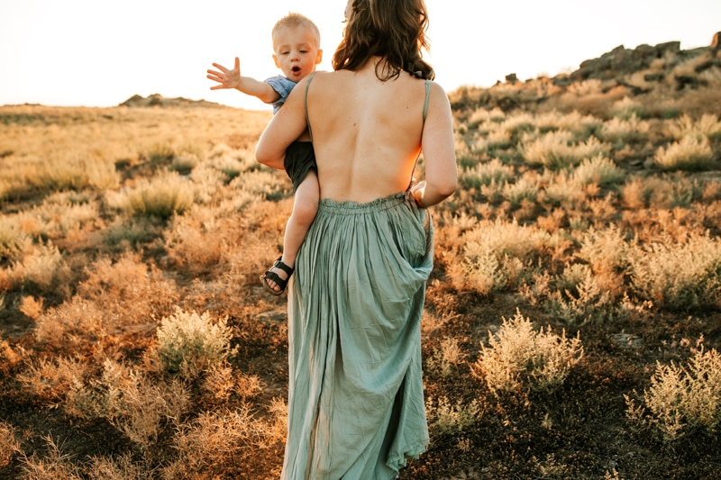 Salt Lake City Birth and Family Photography, mother carrying little boy through field