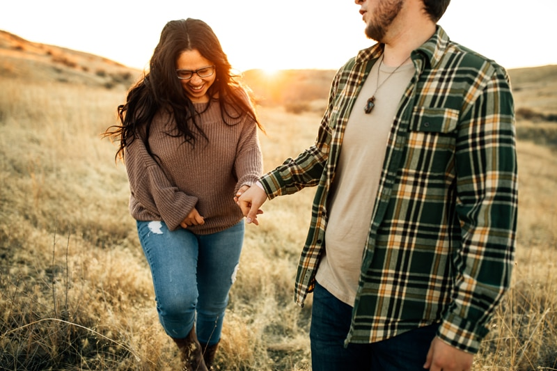 Salt Lake City Birth and Family Photography, couple holding hands and walking through tall grass