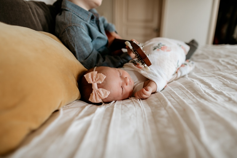 Salt Lake City Birth and Family Photography, baby sitting next to brother playing guitar
