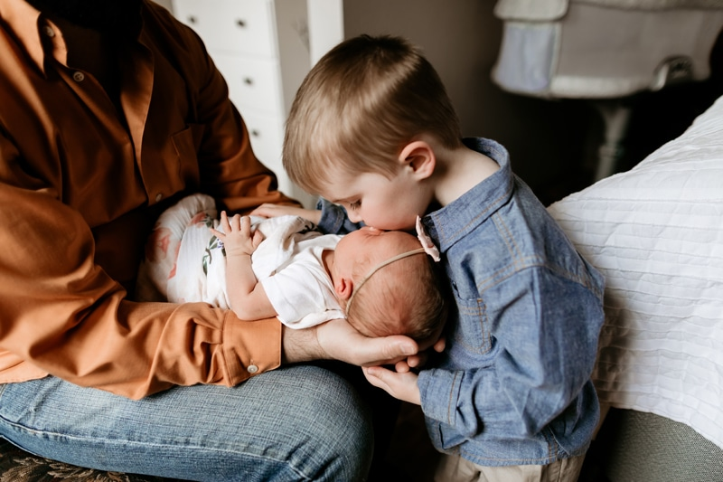 Salt Lake City Birth and Family Photography,little boy kissing baby sister's forehead