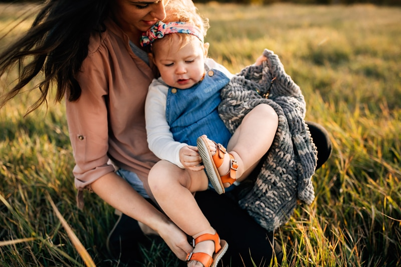 Salt Lake City Birth and Family Photography, mother helping young daughter with her shoes